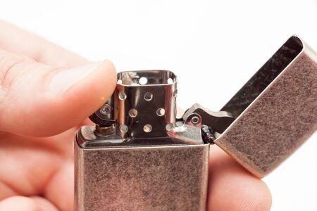 Open lighter in hand  Stock Photo