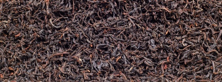 Close up photo of  brown dry tea leaves Stock Photo