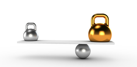 imbalance: Two gold and silver kettlebells  in equilibrium Stock Photo