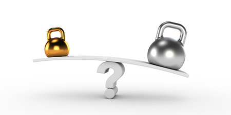equilibrium: Two gold and silver kettlebells  in equilibrium Stock Photo