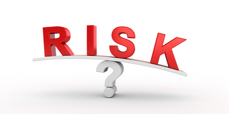 risky: Red risk letters  balancing on question mark