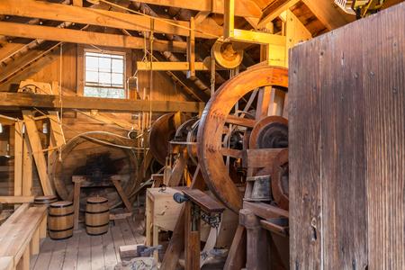 grist: Inside an old vintage wooden grist mill.