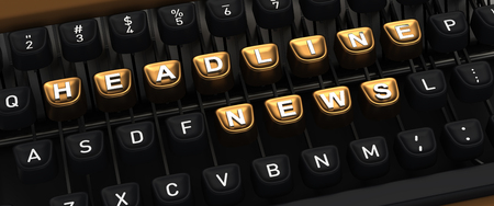 Typewriter with gold buttons in a row, assembling HEADLINE NEWS word Stock Photo