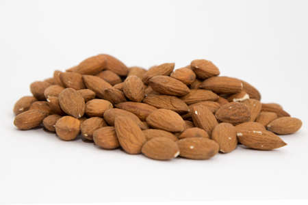 Pile of almonds on white background
