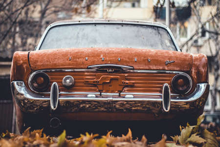 Orange Vintage Car from the Back in Autumn Atmosphere