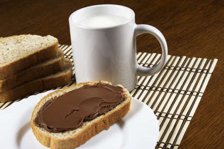 bread with chocolate and a glass of milk photo