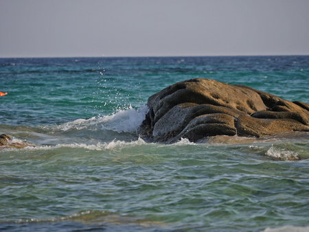 Waves crashing against the rock