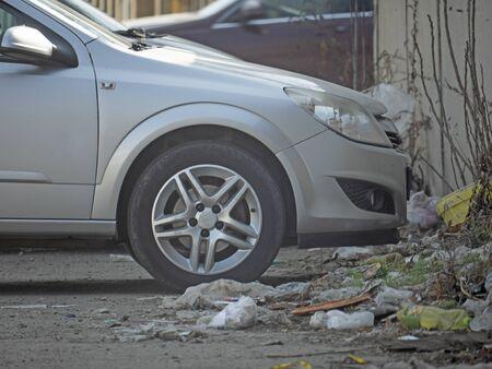 a car parked beside the garbage Zdjęcie Seryjne