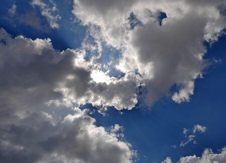 clouds blue sky sun ray Zdjęcie Seryjne