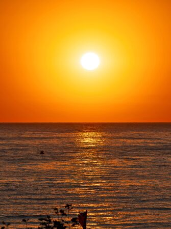 big sun down over sea, red sky