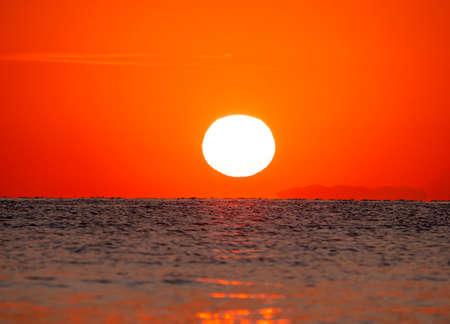 big sun down over sea sunrise, red sky Stok Fotoğraf