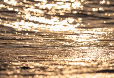 sea wave closeup macro at sunset time Stock Photo