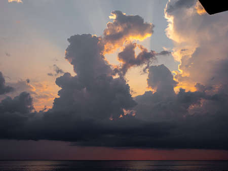 sunrise over sea dramatic big clouds landscape Foto de archivo