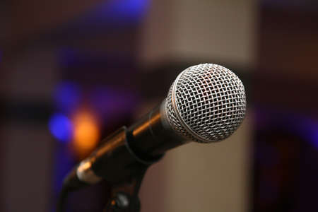 sing music microphone on stage, macro close up Фото со стока