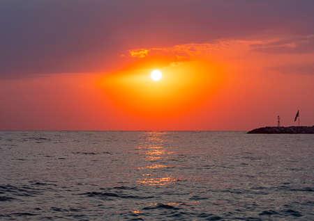 big sun down over sea sunrise, red sky Foto de archivo