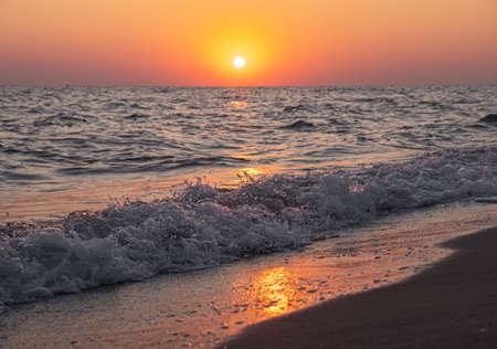 sunrise over the sea and the beach