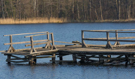 Old boardwalk for fishing almost destroyed in spring over calm water, Bialowieza Forest, Poland, Europe Zdjęcie Seryjne