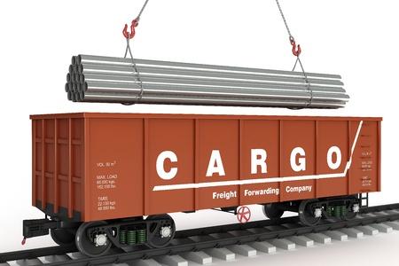 boxcar train: Loading pipes in rail wagon Stock Photo