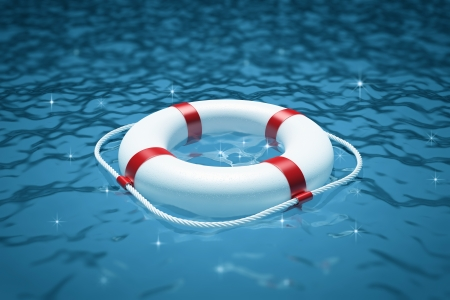 lifebuoy: Life preserver on water Stock Photo