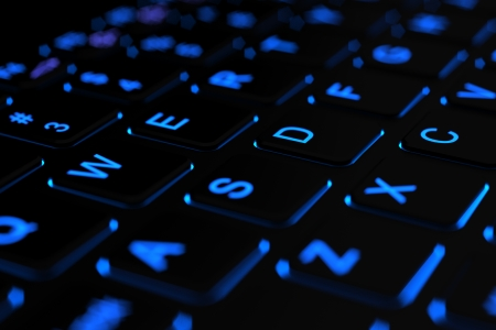 Illuminated laptop keyboard Stock Photo