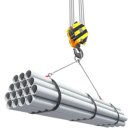 construction crane: Crane hook lifts group of pipes.