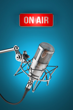 host: Studio microphone stand on background sign light ON AIR Stock Photo