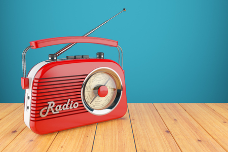 retro radio: Vintage red radio receiver on wood table. Wallpaper 3d