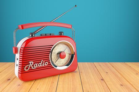 Vintage rode radio-ontvanger op houten tafel. wallpaper 3d Stockfoto