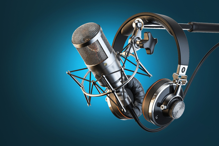 radio station: Headphones on microphone stand, professional studio Stock Photo