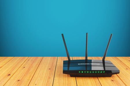 WiFi wireless router on wooden table Stock Photo - 51138467