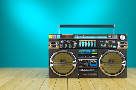 populate: Retro cassette tape recorder on wooden table 3d Stock Photo