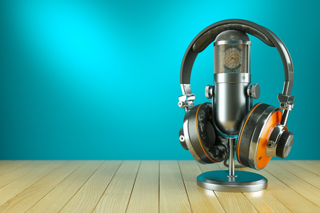 radio station: Professional studio microphone and headphones on wooden table 3d