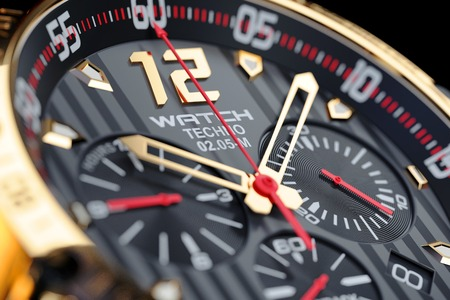 reaches: Golden, luxury men's wristwatch. Clock face close up. Render 3d