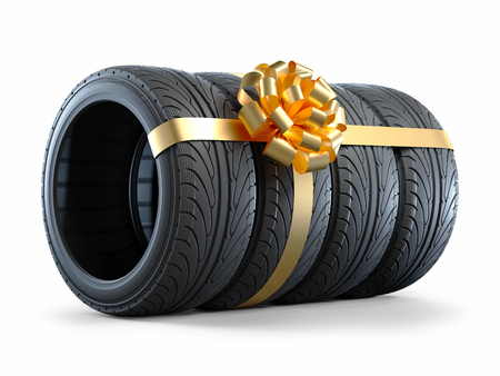 Car tires wrapped in a gift ribbon with a bow. Objects isolated on white background 3d Stock Photo - 93505651