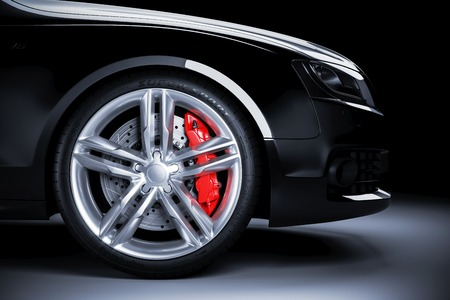 Sports car wheel with red brakes in studio lighting. 3d render Stock Photo