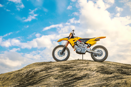 Yellow racing motorcycle on the motocross track. The off the road. 3d render Stock Photo