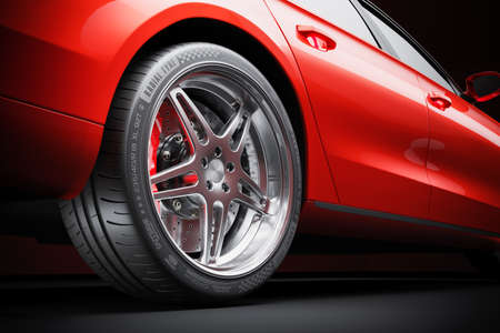 Wheel of red sports car closeup in studio lighting 3d render Stockfoto