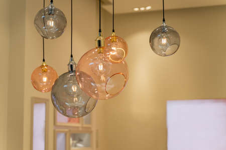 pink and gray round glass chandeliers hanging from the ceiling