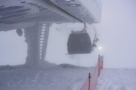 Ski lift in heavy snow. Heavy fog. Bad visibility
