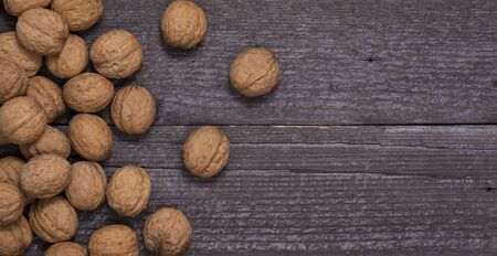 scattering of walnuts on a wooden background