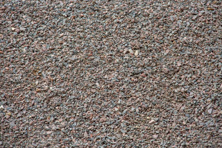 Small granite stones, background, place for text. Copy space