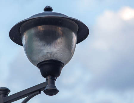 Street lamp close-up against the blue sky