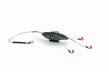 fishing trough spoon, fishing hooks and fishing line, accessories for bottom fishing on a white background close-up 版權商用圖片