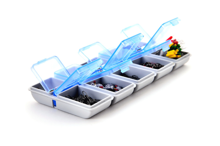 box for fishing accessories on white background, close-up