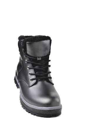 Winter male black leather boot on a white background, hiking shoes, practical off-road shoes, close-up isolate Banque d'images