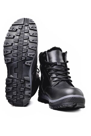 Winter men's black leather boots on a white background, hiking shoes, practical off-road shoes, close-up isolate