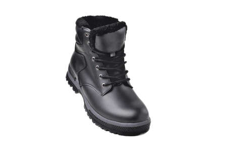 Winter male black leather boot on a white background, hiking shoes, practical off-road shoes, close-up isolate