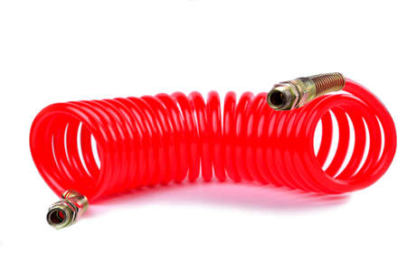 pneumatic hose of a truck for supplying compressed air from a tractor to a trailer white background close-up Stockfoto