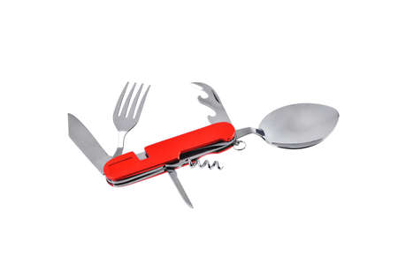 Travel multi-tool with fork, spoon and can opener, multifunctional set, utility knife with travel and tourism accessories set, tourist spoon and fork, close-up white background