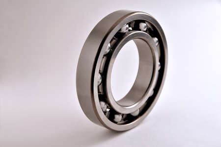 ball bearing on a white background close-up, toning, blur as an artistic device, place for copy space